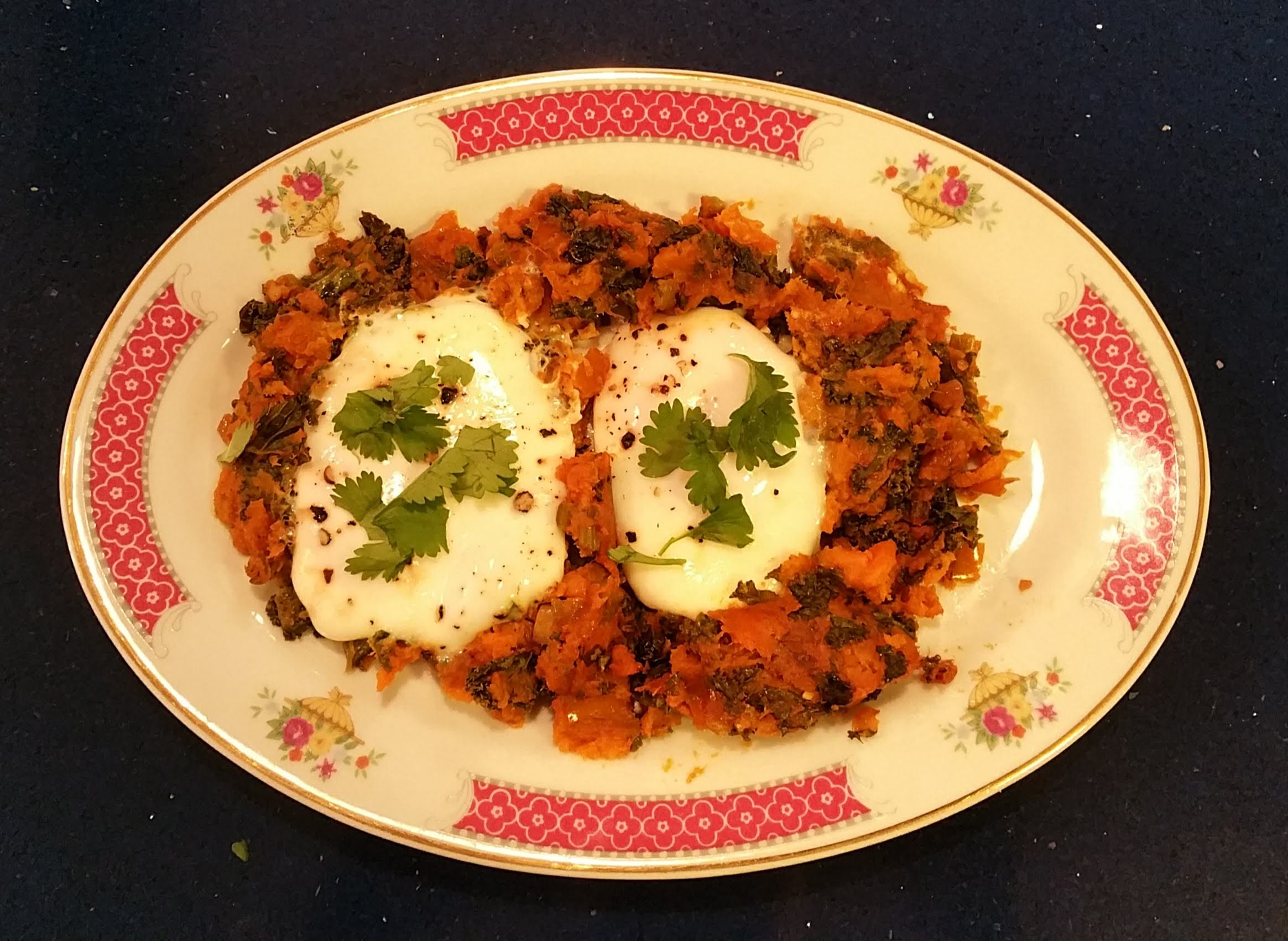 Sweet Potato & Kale Hash topped with Poached Eggs