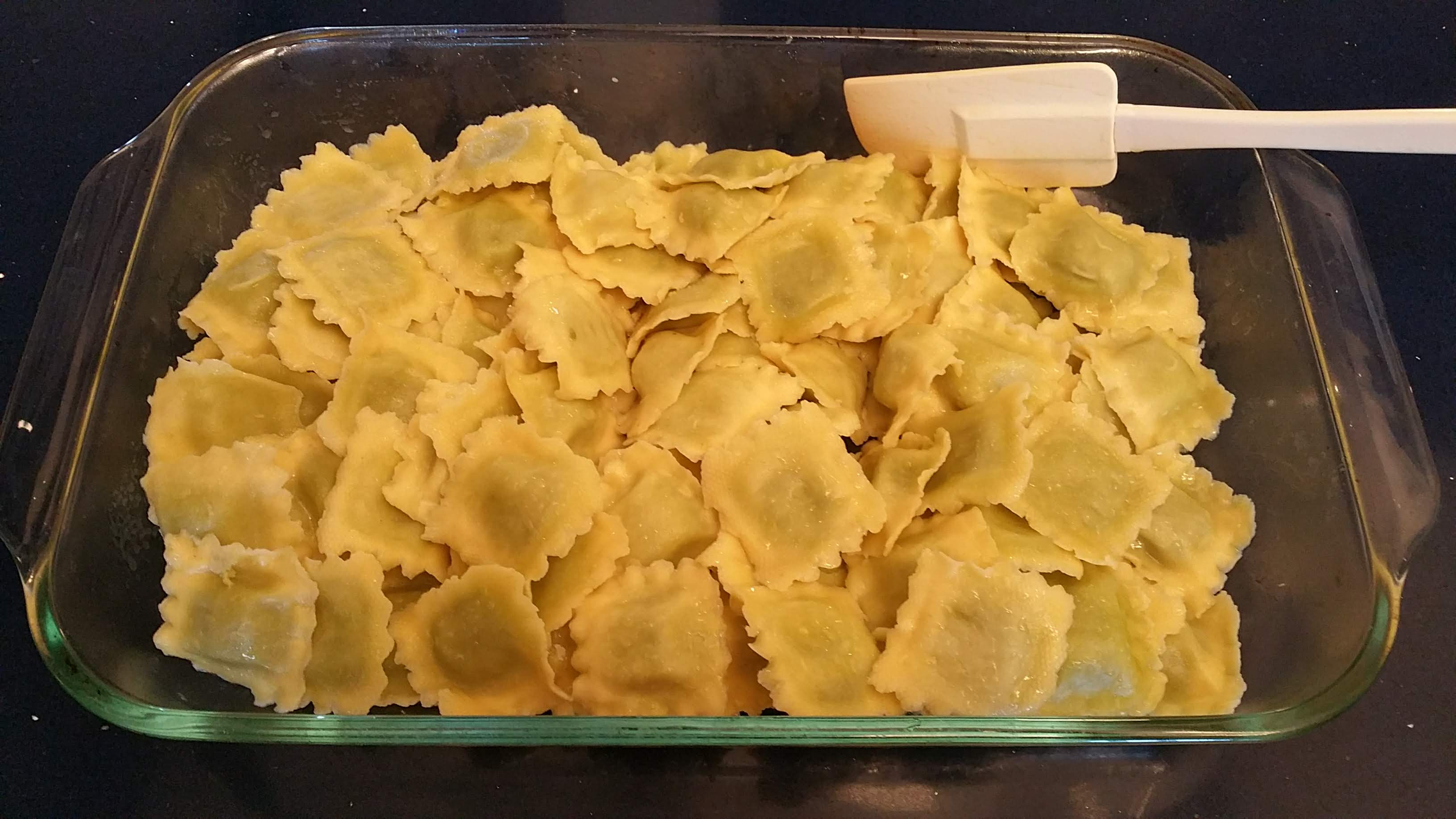 Placing the Ravioli in an Oiled Baking Dish